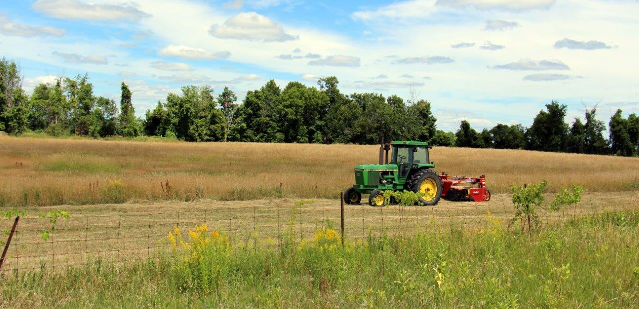 Tractor and Baler in Hay field