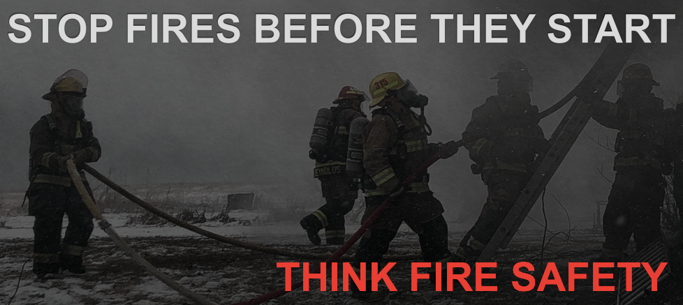 "Fire fighters putting out a fire with caption ""Stop fires before they start - think fire safety"""